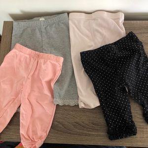 four pairs of 0-3 leggings